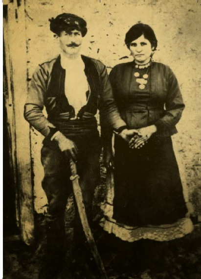 Michael Zachariou Charonitis with his sword staff and his wife Theonimphy.