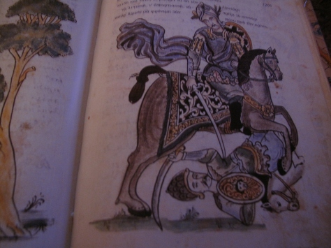 p.71r Charidimos injure with his curved sword his foe Spidolion (Spidolion also use curved sword and buckler like shield.